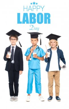 Children in graduation caps dressed in costumes of different professions holding glasses with milk near happy labor day lettering on white stock vector