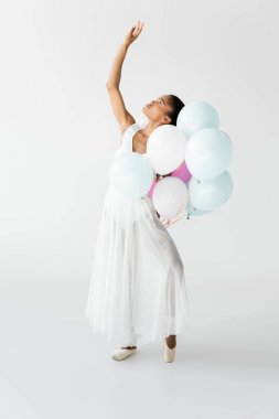 Graceful african american ballerina with balloons isolated on white stock vector