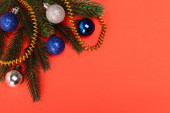 top view of decorated Christmas tree on red background