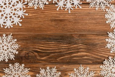 Top view of winter snowflakes on wooden background stock vector