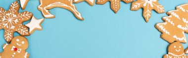 Top view of winter gingerbread cookies on blue background, banner stock vector