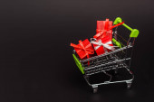 shopping cart with valentines gifts isolated on black
