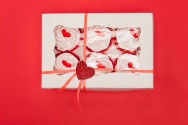 Top view of box with valentines cupcakes isolated on red stock vector