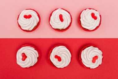 Top view of valentines cupcakes on pink and red background stock vector
