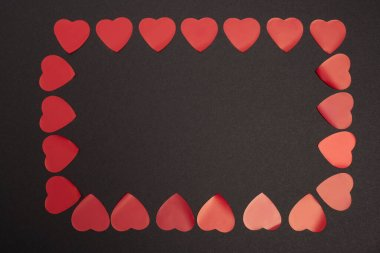 Top view of valentines frame of hearts isolated on black stock vector
