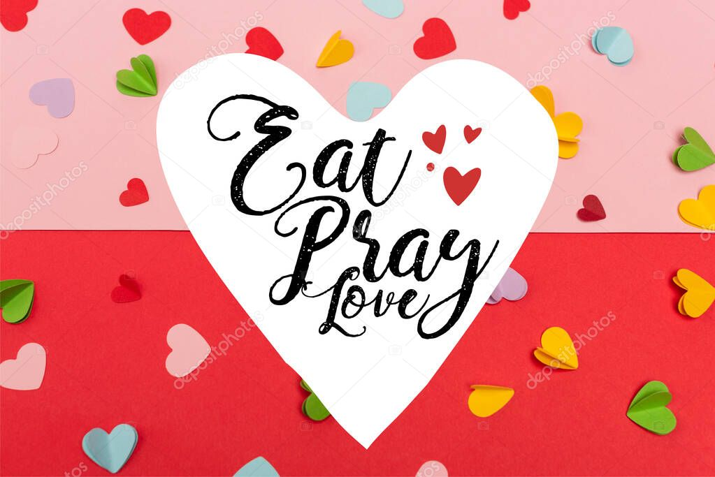 Top view of colorful paper hearts near eat pray love lettering on red and pink stock vector