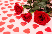 red hearts and roses on pink background