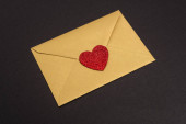 valentines envelope with heart isolated on black