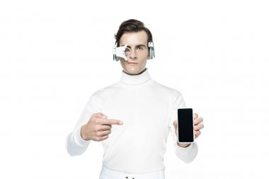 Cyborg in eye lens and headphones pointing with finger at smartphone with blank screen isolated on white stock vector