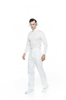 Cyborg in digital eye lens and headphones walking isolated on white stock vector