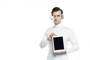 Cyborg man in digital eye lens and headphones showing digital tablet with blank screen isolated on white stock vector