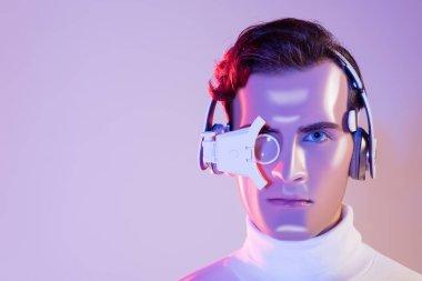 Portrait of cyborg in headphones and digital eye lens on purple background stock vector
