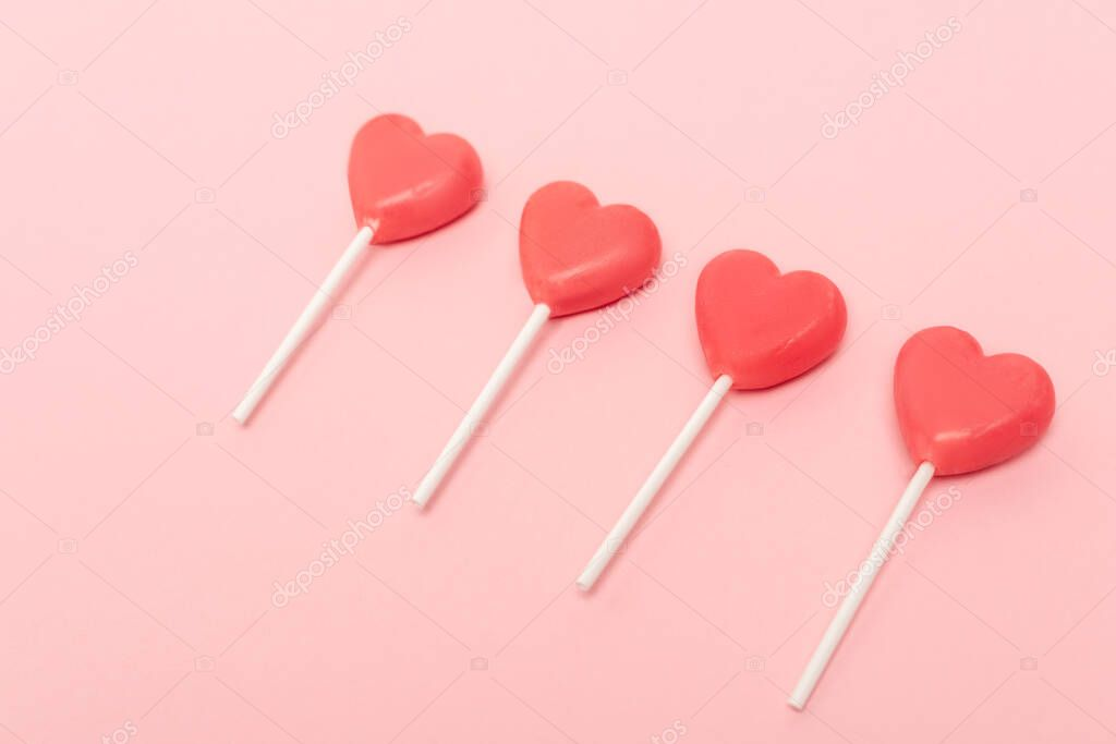 Heart shaped lollipops on pink background stock vector
