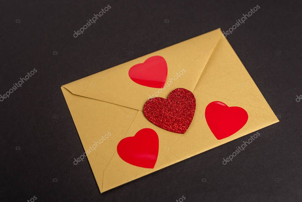 Envelope with hearts isolated on black stock vector