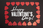 top view of happy valentines day lettering in frame of hearts on black