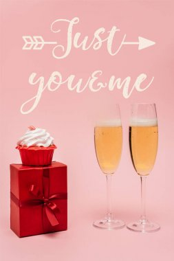 Champagne glasses near gift, cupcake and just you and me lettering on pink stock vector