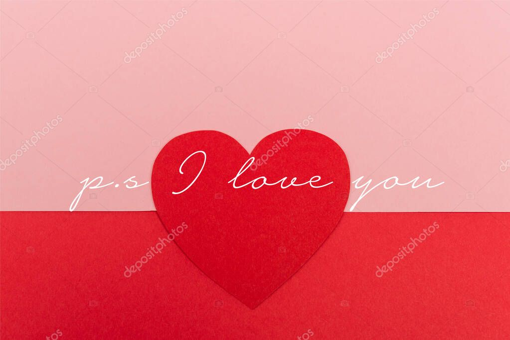 Top view of paper heart near ps i love you lettering on red and pink background stock vector