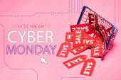 Verkaufsetiketten in Warenkorbnähe und bis zu 70 Prozent Rabatt, Cyber-Monday-Schriftzug auf rosa, Black-Friday-Konzept