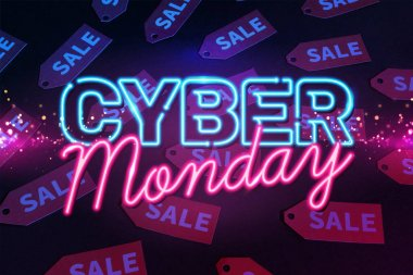Neon cyber monday lettering near red labels on black background stock vector