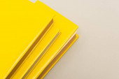 yellow copy books isolated on grey with copy space