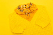 top view of scarf with ornate and clothing isolated on yellow
