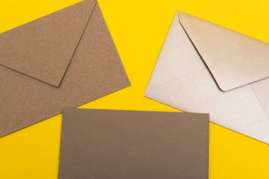 Top view of paper envelopes isolated on yellow stock vector