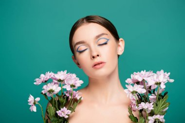 Sensual woman with closed eyes near pink chrysanthemums isolated on green stock vector