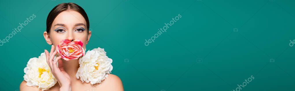 Charming young woman with fresh peonies looking at camera isolated on green, banner stock vector