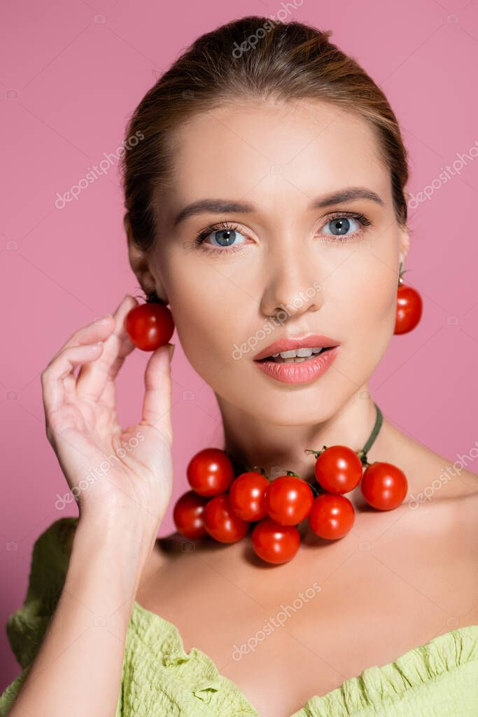 Sensual woman in necklace and earrings made of red cherry tomatoes on pink stock vector