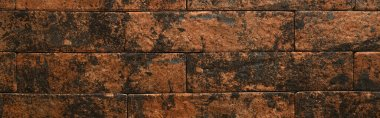 background of brick wall in brown and black gradient, top view, banner