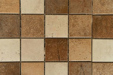 Background of square ceramic tiles, with brown and beige stone imitation, top view stock vector