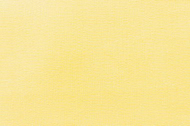 Yellow wallpaper with textured surface, top view stock vector