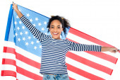 excited african american woman holding usa flag while smiling at camera isolated on white