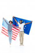 cheerful african american couple holding usa and european union flags on white
