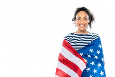 Cheerful african american woman, wrapped in usa flag, smiling at camera isolated on white stock vector