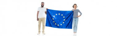 Full length view of happy african american couple standing with european union flag on white, banner stock vector