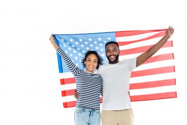 Joyful african american couple holding usa flag while looking at camera isolated on white stock vector
