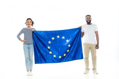 Young african american couple smiling at camera while holding european union flag on white stock vector