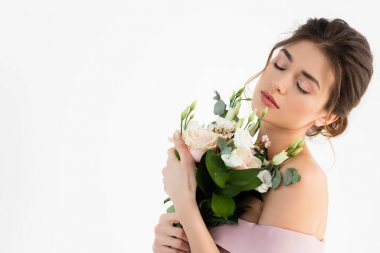 Young fiancee holding wedding bouquet while posing with closed eyes isolated on white stock vector