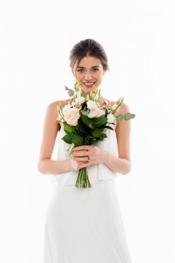 Cheerful woman in wedding dress holding bouquet isolated on white stock vector