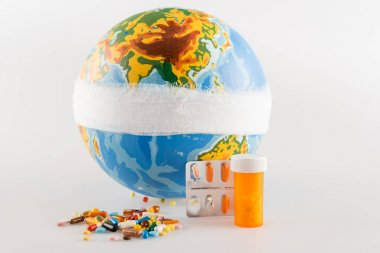 Bandaged globe near medicines on grey background, ecology concept stock vector