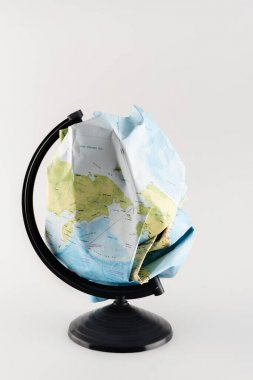 Crumpled map instead of globe on stand isolated on grey, ecology concept stock vector