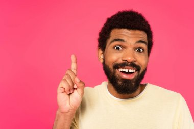 Excited african american man having idea isolated on pink stock vector