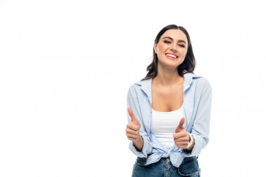 Excited woman in blue shirt showing thumbs up isolated on white stock vector