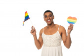 happy african american transsexual man holding lgbt flag and paper heart in rainbow colors isolated on white