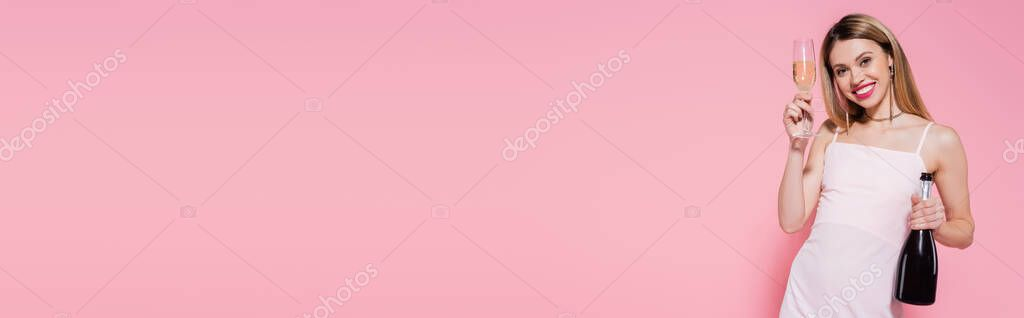 Smiling woman holding bottle and glass of champagne on pink background, banner stock vector