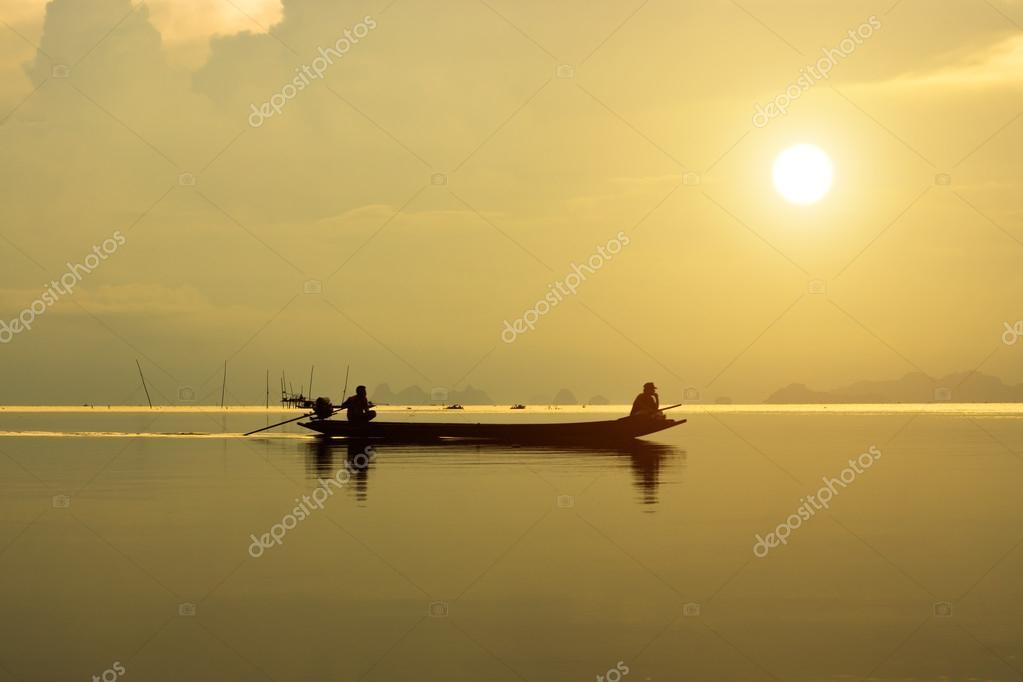 fisherman at the lake, Thailand.