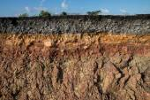Photo The curb erosion from storms. To indicate the layers of soil and