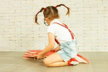 Preschooler girl with books