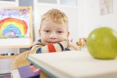 Preschooler with green apple
